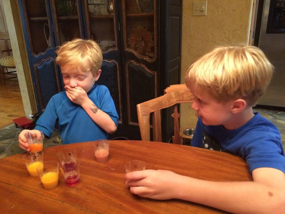 Grandkids juice tasting 2015